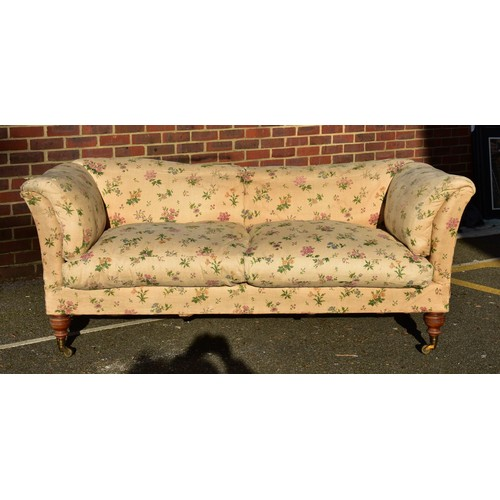 1433 - A Howard & Sons 'Baring' settee,on turned walnut legs to the front, all castors stamped, labell...