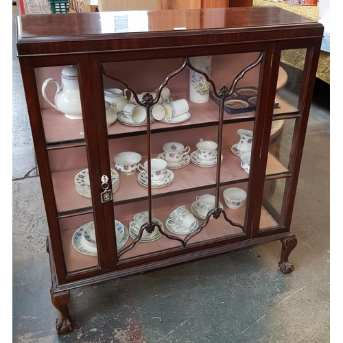 37 - Early 20th c mahogany display cabinet with glazed door, silk effect lining on ball and claw feet H45...