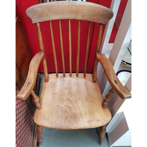 24 - 19th C oak country style stick back windsor fire side carver chair H38'' W22'' D17''...
