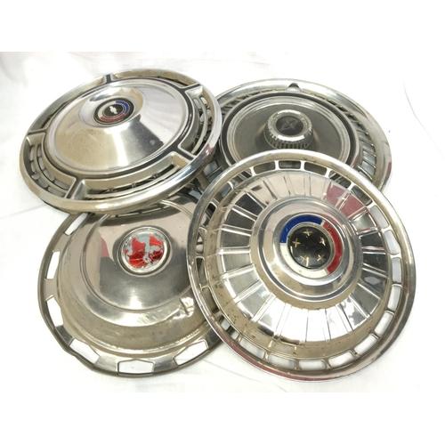 39A - Four vintage International Automobile chrome hub caps with logo's 15ins diameter...