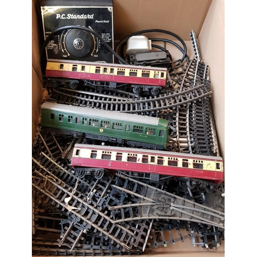 17 - Three vintage OO gauge Triang Passenger carriages plus P.C Standard power unit and quantity of rail ...