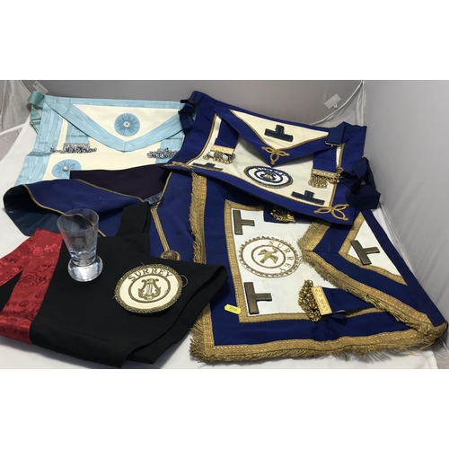 28 - Quantity of vintage Masonic related items includes three aprons, sash, two other garments, a braided...