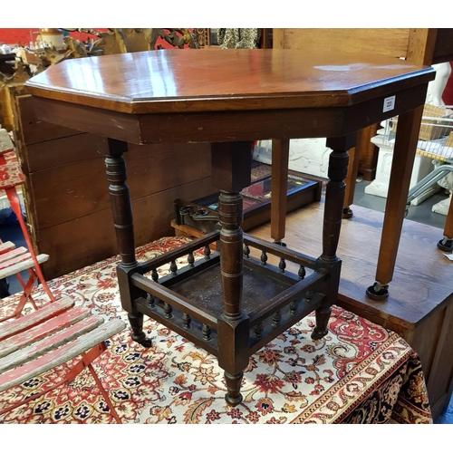 24 - Late 19th C mahogany octagonal two tier side table/trolley with gallery base H28ins Diameter 30ins...