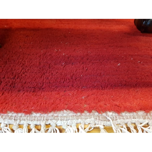 21 - Persian style woven rug runner in red livery size 107ins x 35ins...