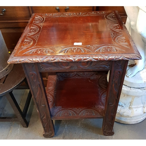 42 - Early 20th C mahogany two tier side table with carved relief H31ins top 24ins x 24ins...