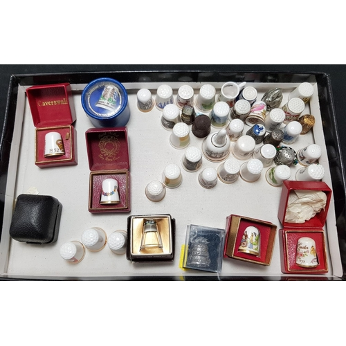26 - Collectors china thimble stand by Caverswall plus quantity of china and metal thimbles includes Snow...