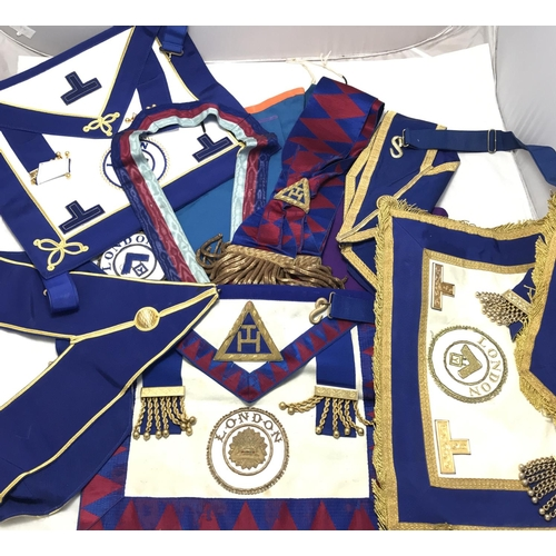 35 - Quantity of vintage Masonic items includes three sashes, three aprons, two other garments and a brai...