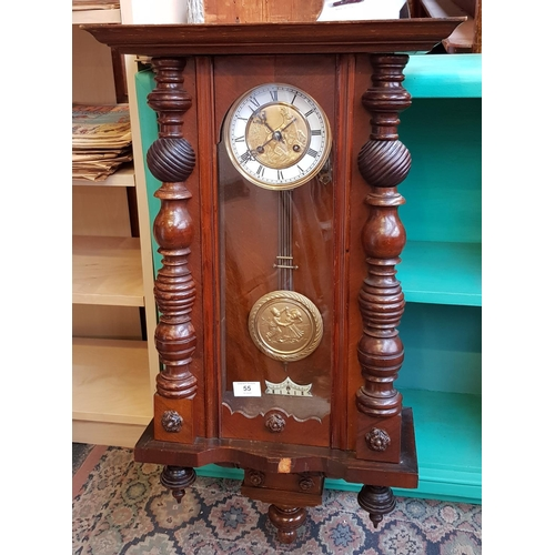 34 - Early 20th C mahogany case wall clock with metal and enamel dial, raised stag relief and pendulum vi...