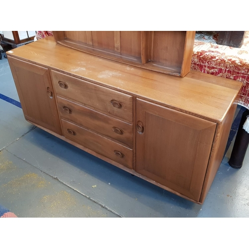 2 - Mid 20th C vintage honeyoak ercol side buffet with three drawers and two cupboards below H27ins W61i...