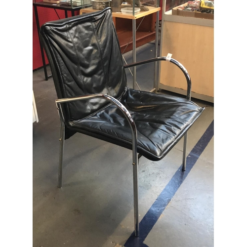 55 - Contemporary designer chrome frame carver chair with faux leather upholstery H32ins W9ins D19ins...