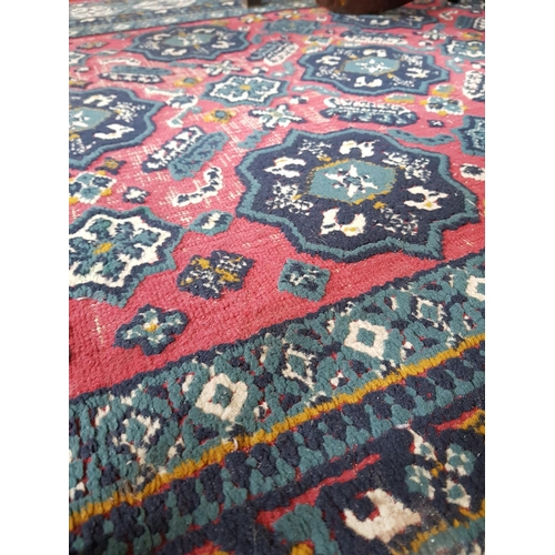11 - Persian style red and blue ground floor rug 63ins x 46ins...