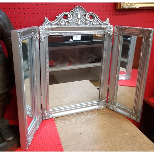 52 - Regency style silvered frame tri-fold vanity mirror with carved relief H22ins open W30ins...