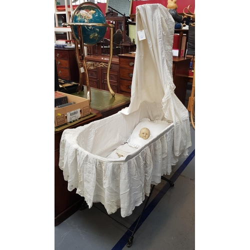 8 - Late 19th early 20th c dolls/babies metal frame cradle with makers mark Universal Cot Co. 65ins H x ...
