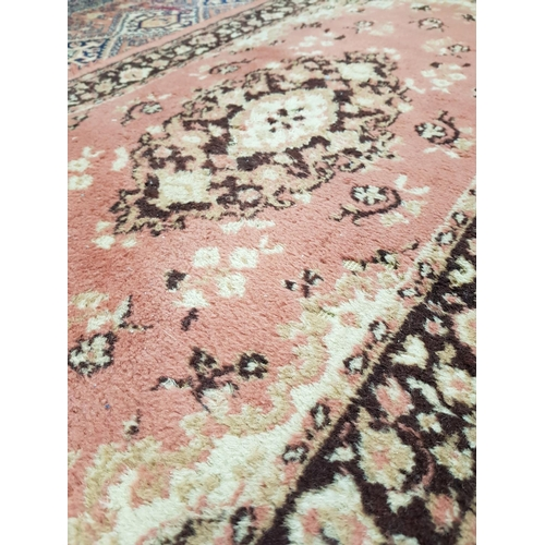 41a - Vintage pink ground Persian style floor rug 54ns x 27ins plus one other similar style...