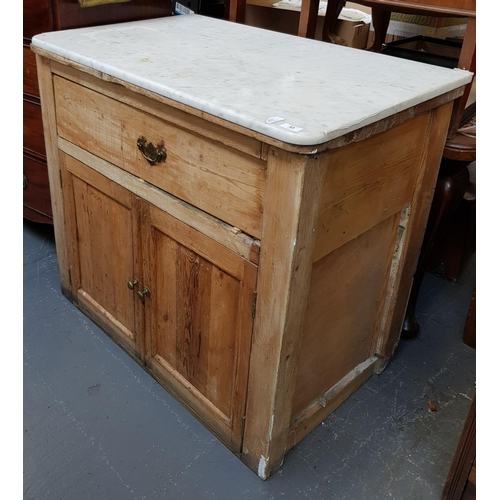 43 - 19th C pine serving cabinet with white marble top with drawer cupboard below H35ins W38ins D24ins...