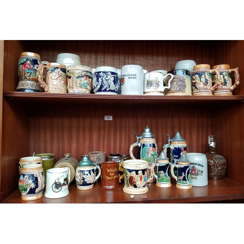 45 - Rare continental china moustache stein H4.5ins plus other stoneware steins and tankards, 30 items in...