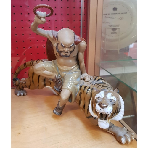 43 - Glazed china group sculpture Oriental hunter and tiger 9