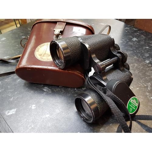 2 - Pair of vintage Carl Zeiss Jena 10x50w binoculars in original leather carrying case...