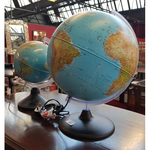 23 - Two 20th C vintage perspex World globe table lamps largest H16ins...
