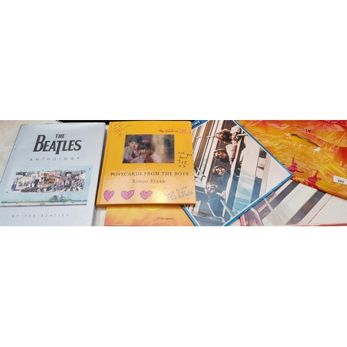 34 - Hardback book Beatles anthology plus book postacrds from the boys, Beatles Show catalogue and two do...