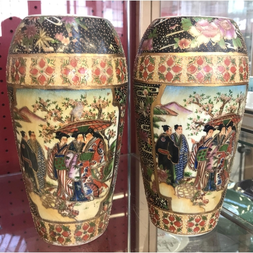 43 - Pair of oriental china vases group gentleman and maiden scenes with foliage and gilt relief H9ins...