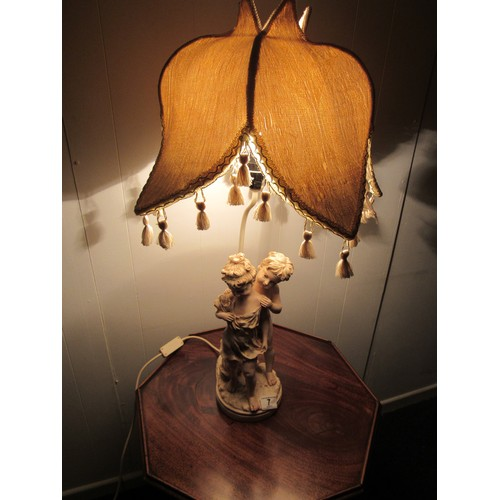 7 - Vintage, resin, figural, table lamp with a tulip shade. 74cm high...
