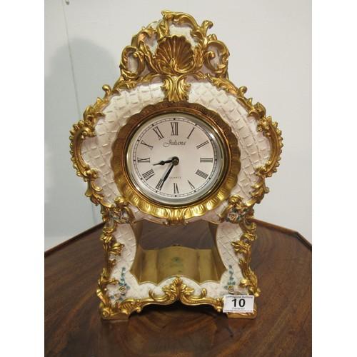 10 - Resin, Juliana, quartz, ornate clock in a French Louis XV style. 35cm h, 21cm w...