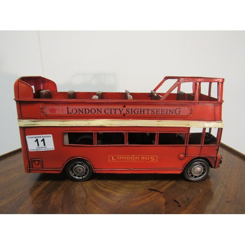 11 - Tin toy, London, double decker bus. 30cm long, 17cm high, 10cm wide...