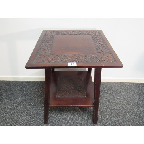 12 - Arts & Crafts, mahogany. two tier, side table/plant stand, with carved foliate relief 48cm square at...