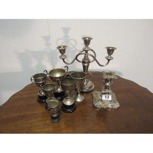 13 - quantity of silver plated ware, including a three branch candelabra, decorative candle stick and six...