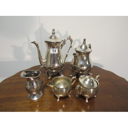 14 - Plated tea set and decorative engraved milk jug...