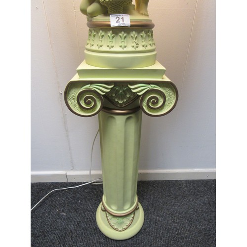 21 - A very fine figural, resin lamp, decorated with angels/cherubs on a matching pedestal. 150cm overall...