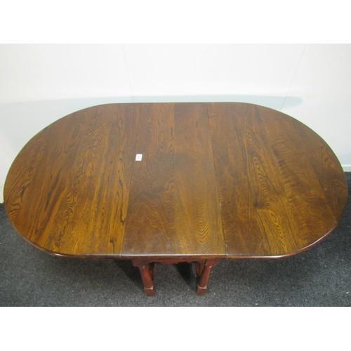 22 - A fine, solid oak, drop leaf, gate leg dining table. 75cm h, 90cm d, 153cm w when open, 41cm closed...