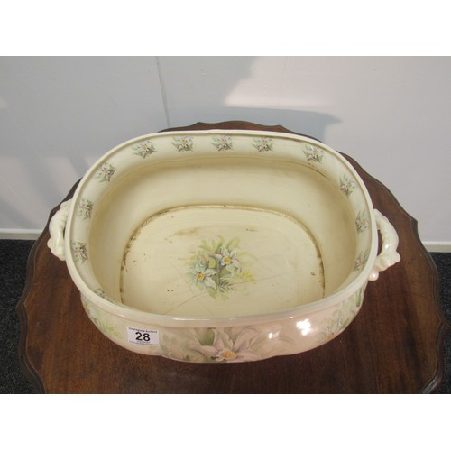 28 - A fine, large, ceramic foot bath, having been used as a  planter. Hairline crack to inner base which...