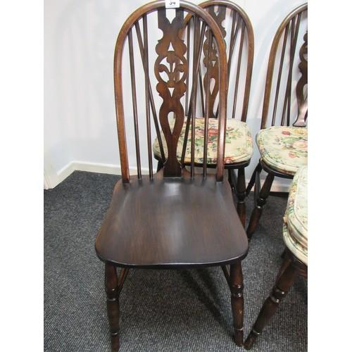 34 - Set of four, oak, wheelback dining chairs with Fleur De Leys pierced splat back decor and stud faste...