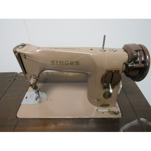 38 - Singer sewing machine set within a table, for cosmetic restoration. 79cm h, 42cm d, 59cm w...