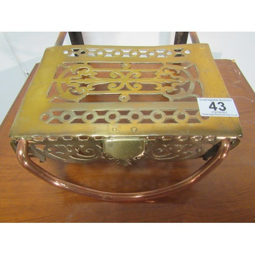 43 - A very rare, copper and brass, early 19th century, range trivet 33cm d, 23cm w...