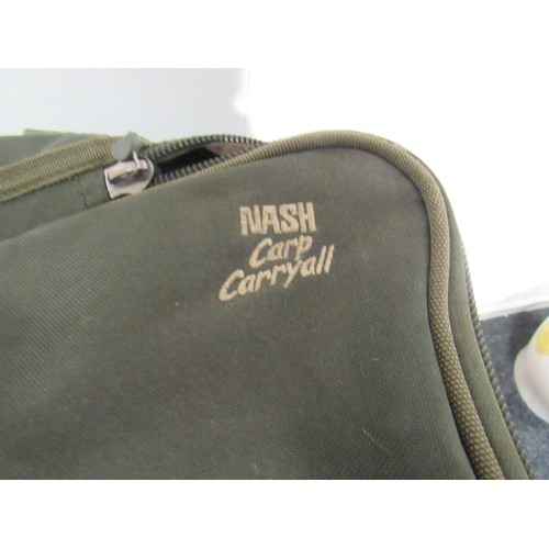 46 - Large canvass fishing tackle bag, stamped 'Nash carp carry', including contents. New and vintage box...