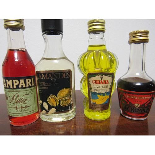 56 - Quantity of four vintage miniatures, cherry brandy, banana liqueur, Almond liqueur and Campari...
