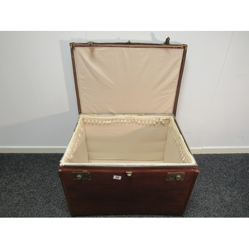 59 - Canvass, lined travel trunk. 69cm w, 54cm d, 52cm h...
