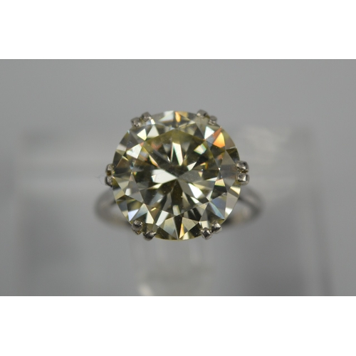 54 - A platinum diamond solitaire ring, the brilliant cut 9.35ct diamond in a six double claw setting, 6....