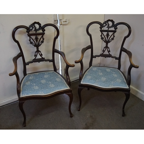 60 - Two carved chairs 98cm x 48cm x 62cm...