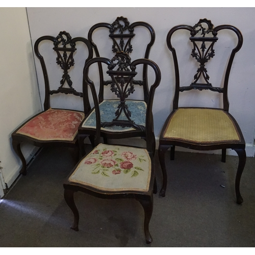 14 - Four carved back chairs two larger chairs measure at  44cm x 45cm x 97cm and two smaller ones at 43c...