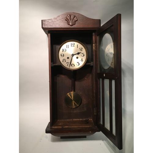 37 - Cased wall clock 17cm x 34cm x 79cm...