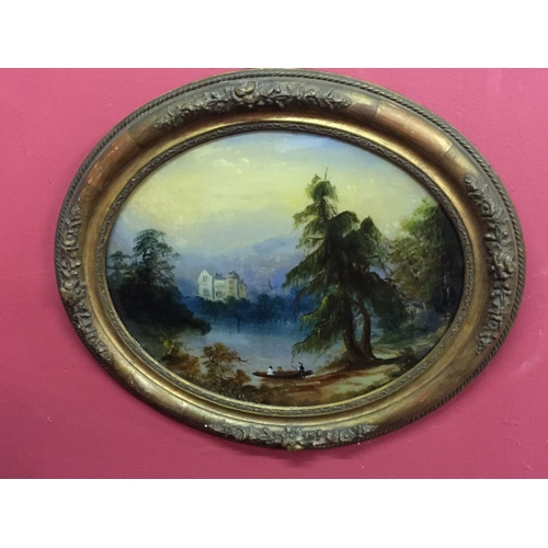 38 - Oval gilt frame painting on glass of a lake sence with castle in the backround...