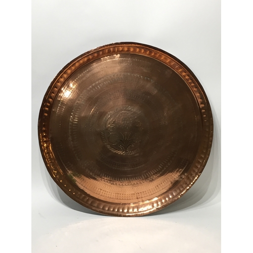 55 - A good quality copper tray 58cms diameter...