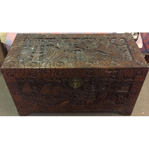 56 - Profusely Carved Camphor Wood Trunk. 105 X 52 X 57 Cms....