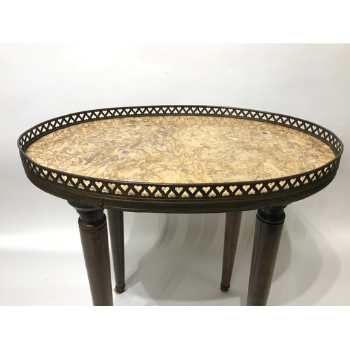 8 - Marble Tob Oval Table Of Small Proportions With Brass Gallery . 46 x 30 x 45 cms...