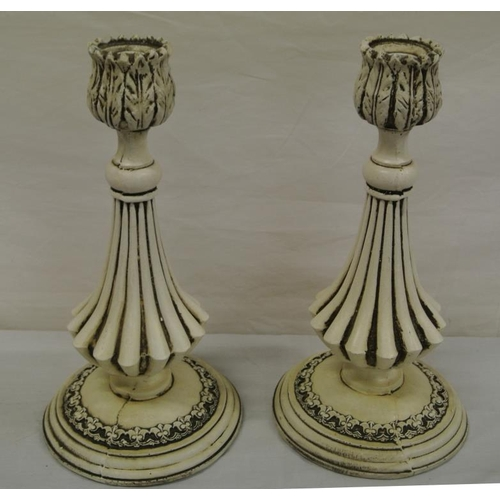 23 - Pair of carved candlesticks with foliate decoration...