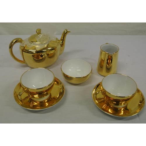28 - 7 piece gilt decorated Royal Worcester tea set...